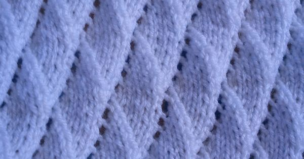 Knitting Yarn Over Purl Stitch : Cot blanket using the quot overlapping waves stitch
