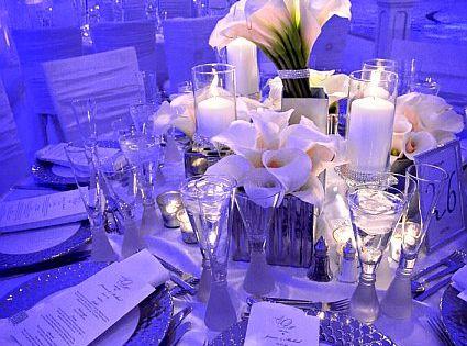 love the lighting against the white decor. wedding reception