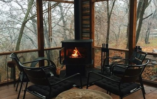 Wood burning stove on the cabin screened porch for Wood burning stove for screened porch