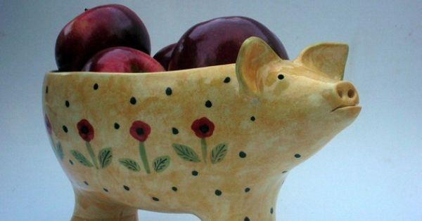 Ceramic pig bowl chockful of apples | art in three ...