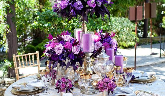 Beautiful tall centerpiece with purple and gold accents. We can customize this arrangement just for you! http://www.CreativeAmbianceEvents.com
