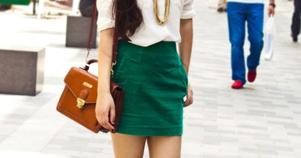 green skirt, white blouse, and gold chain