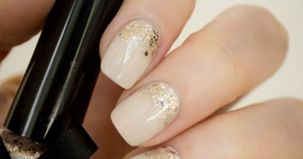 15 Holiday Nail Designs // nude nails with gold glitter