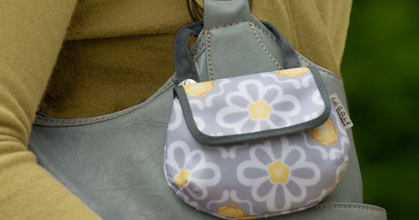 so cute! pacifier pods that clip to the outside of diaper bag