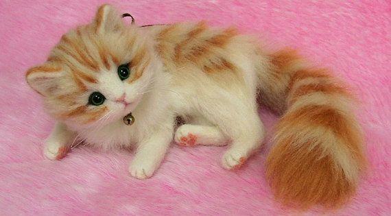 Needle felted fluffy orange tabby kitten. This kitten is