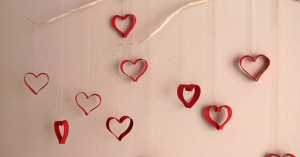 wall hanging toliet paper rolls...Valentine photoshoot backdrop!
