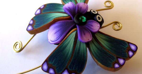 Polymer clay butterfly. Stretched polymer cane flowers for wings?