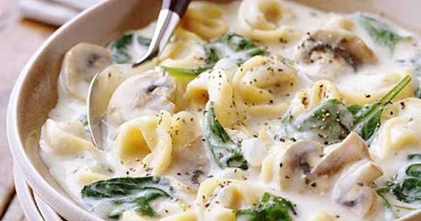 Creamy Tortellini Soup Recipe. Spinach, cheesy tortellini, and fresh mushrooms make this