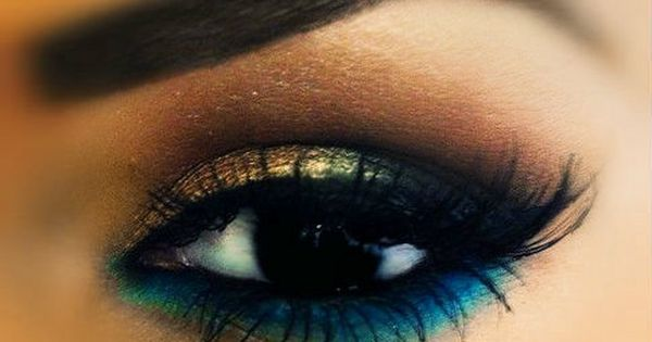 Smokey gold and blue underneath (mermaid eye make- up)