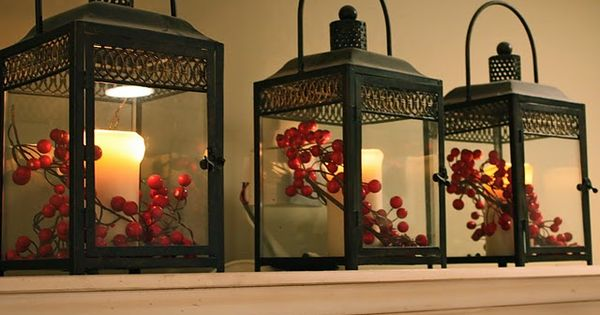Candles in Lanterns with berries. - Love the lanterns. - The Yellow