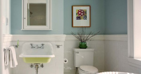 Like the floor and sink... Great paint color for a small bathroom