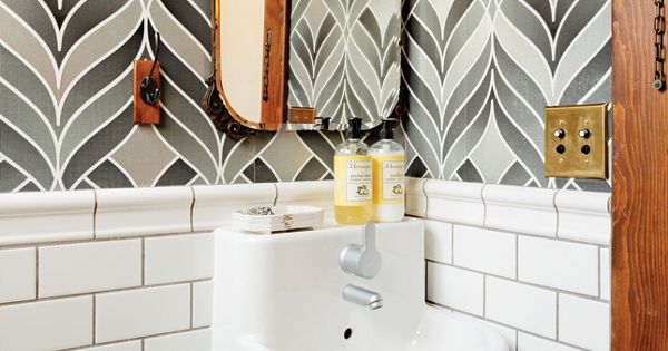 Wallpaper + subway tile + small sink in half bath
