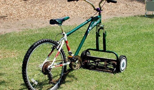 "Riding. Lawnmower. ""Hey, kids! Let's go ride bikes in the yard!"""