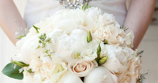 Elegant bouquet consisting of white Peonies, ivory Roses and blush Hypericum Berries.