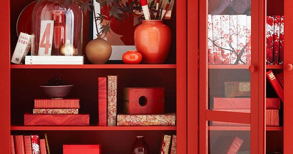 Red bookcase, books, accessories… this may be just what I need to
