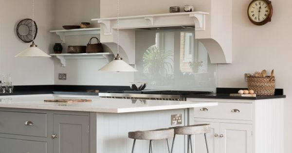 Light Blue Gray Island With Dark Blue Base Cabinets And
