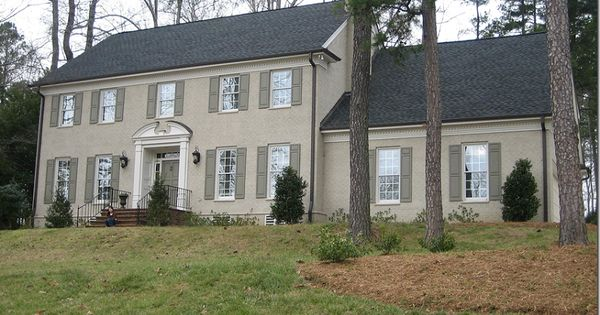 Painted taupe brick house with moss green shutters for Brick houses without shutters