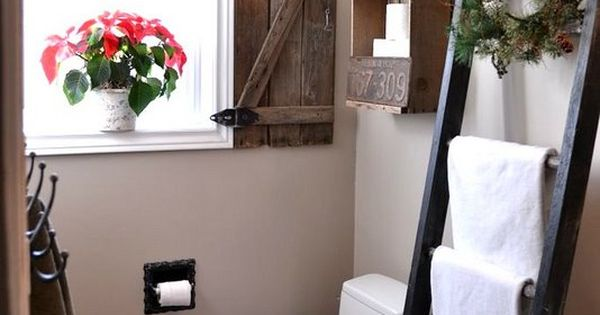 Ladder towel rack, box above toilet, cool the window shutter