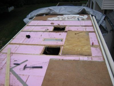 An Rv In The Middle Of A Roof Replacement Rv Roof Repair Camper Repair Roof Repair