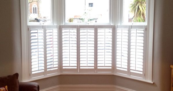 Cafe Style Shutters On A Victorian Bay All Closed