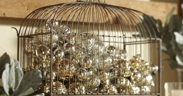 Wrought Iron Birdcage full of Christmas decorations | Pottery Barn