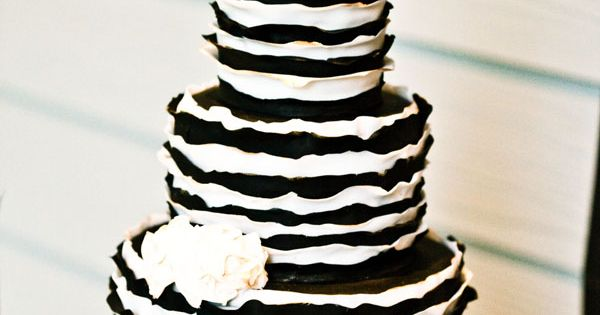 Black and white cake with gold cake stand and gold letter