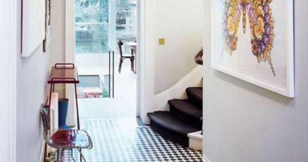 Black and white tiled floor; black stair runner. Poss basement idea?