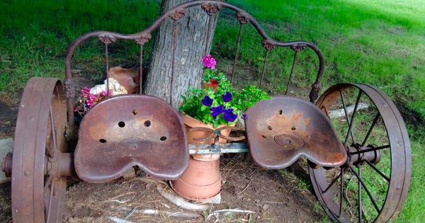 Old Iron Headboard Wheels And Tractor Seats Repurposed
