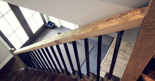 rustic natural wood stair rail with steel pipe spindles ...