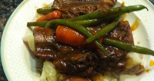 Beef short ribs. Slow cooked. Served with carrots and green beans over ...