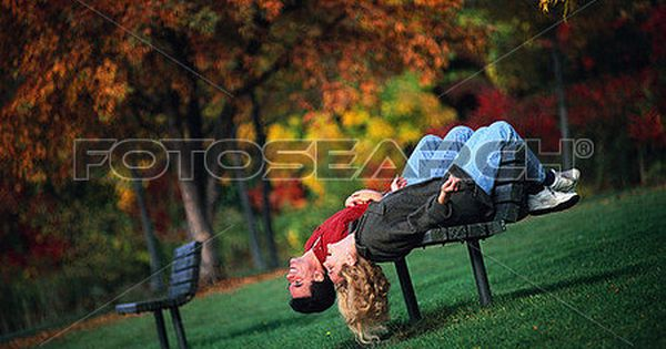 Couple Hanging Upside Down From Park Bench View Large Photo Image Park Bench Photo Bench