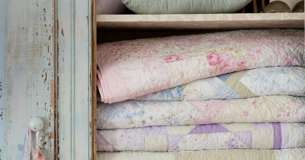 vintage linens in Country French cupboard