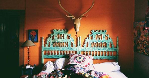 great eclectic bedroom, nice deer head