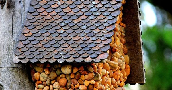 DIY BIRDHOUSE with pebbles and a roof made of pennies. Many other