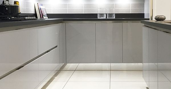Gloss Mackintosh Kitchen In Light Grey And White With
