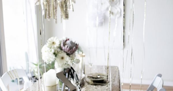 A GLITTER PARTY!, glitter tablecloth, sparkly tassel garland. New years eve party?