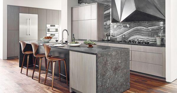 Dark countertop and mercury black marble backsplash for Black washed kitchen cabinets