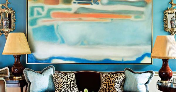 Miles Redd. Love the royal blue walls, traditional rug and stunning abstract
