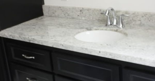 Bianco romano granite on black vanity guest bath for for Granite remnants los angeles ca