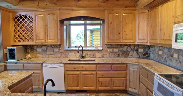 Rock backsplash in cabin kitchen kitchen features stone for Log cabin kitchen backsplash ideas