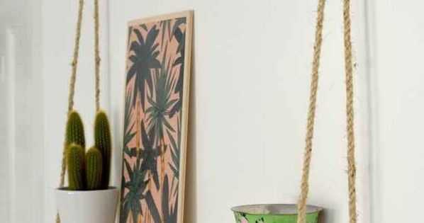Tie sisal rope onto a painted board to create a simple hanging