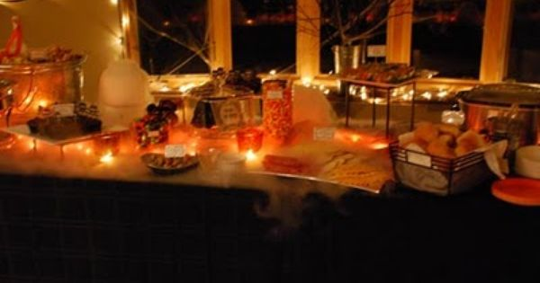 String Lights Under Table : We used black table cloths, filled large jars with dry ice and water and bunched a string of ...