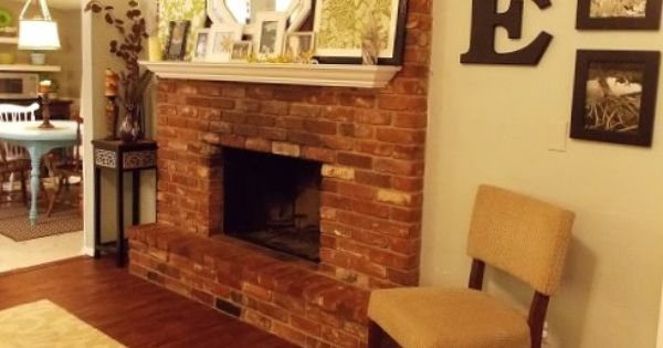 White Mantel Red Brick Fireplace How To Drill Into A Brick Fireplace And Hang A Mantel On The