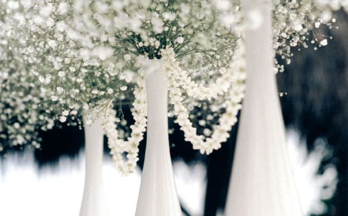 I will have white vases like this with balls of the carnations