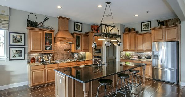 Gehan homes kitchen black granite countertops brown wood for Kitchen cabinets houston tx