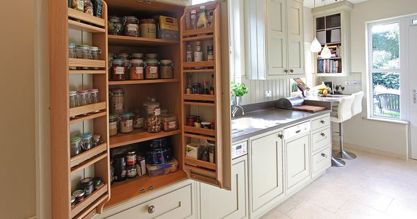 Bat wing pantry cabinet in galley kitchen bespoke small for Kitchen units spain