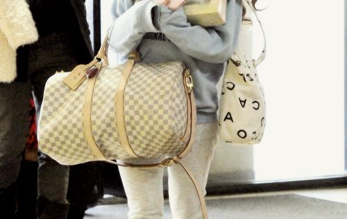 Ariana Grande traveling wear. should always be comfy and warm on a