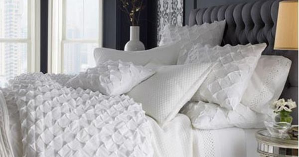 Love the textured white bedding. I want a grey and white bedroom