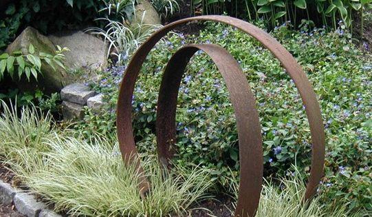 garden sculpture from old wine barrel rings Smart art!