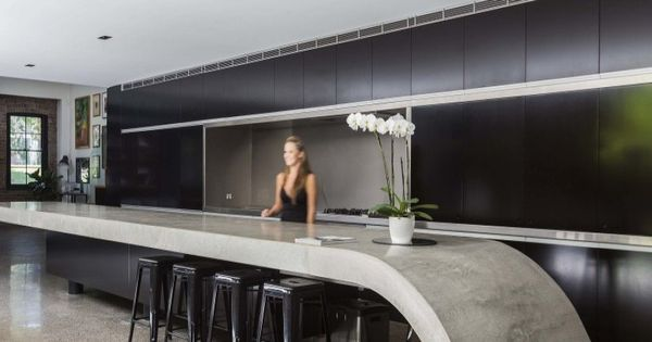 Masculine Kitchen Matt Black Handleless Cabinets Thick Grey Concrete Look Curved Wave Benchtop